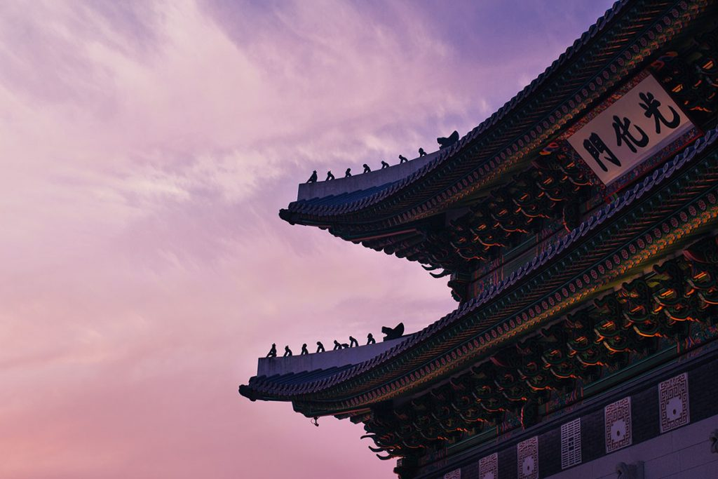 The corner of a Chinese temple at sunset