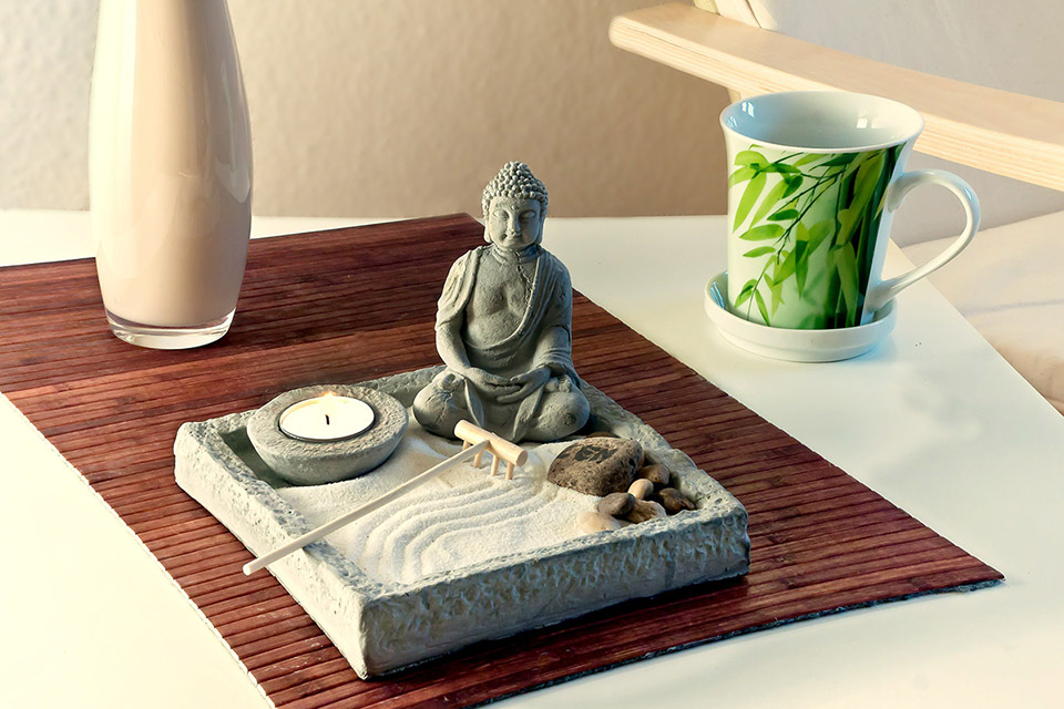 Feng Shui arrangement with a mini Buddha garden on a table
