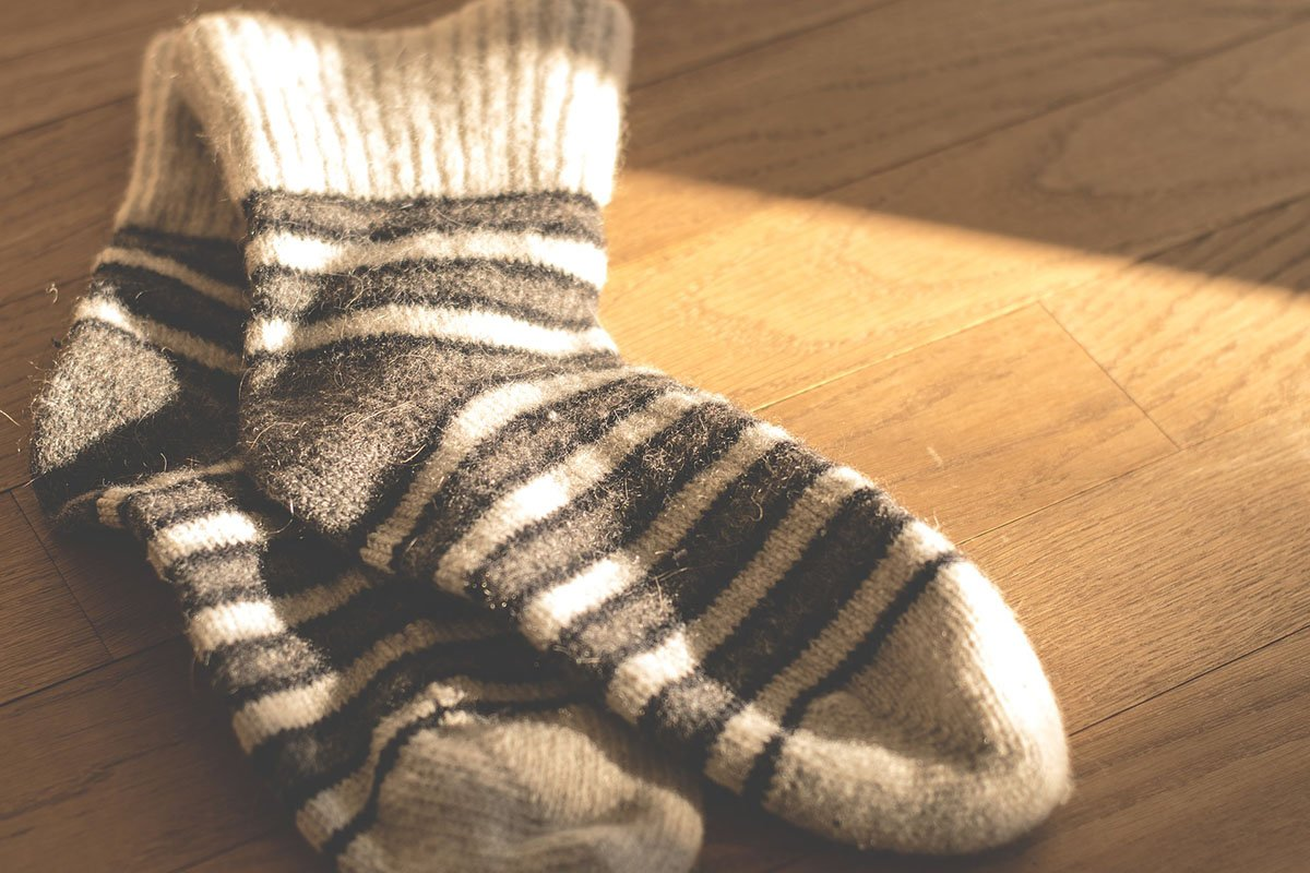 Best bamboo socks laying on a wooden floor