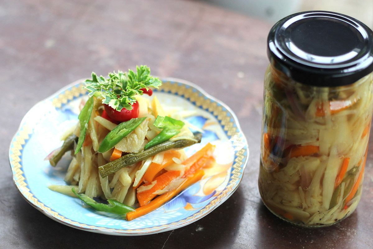 Edible bamboo shoots on a plate and canned in a glass jar