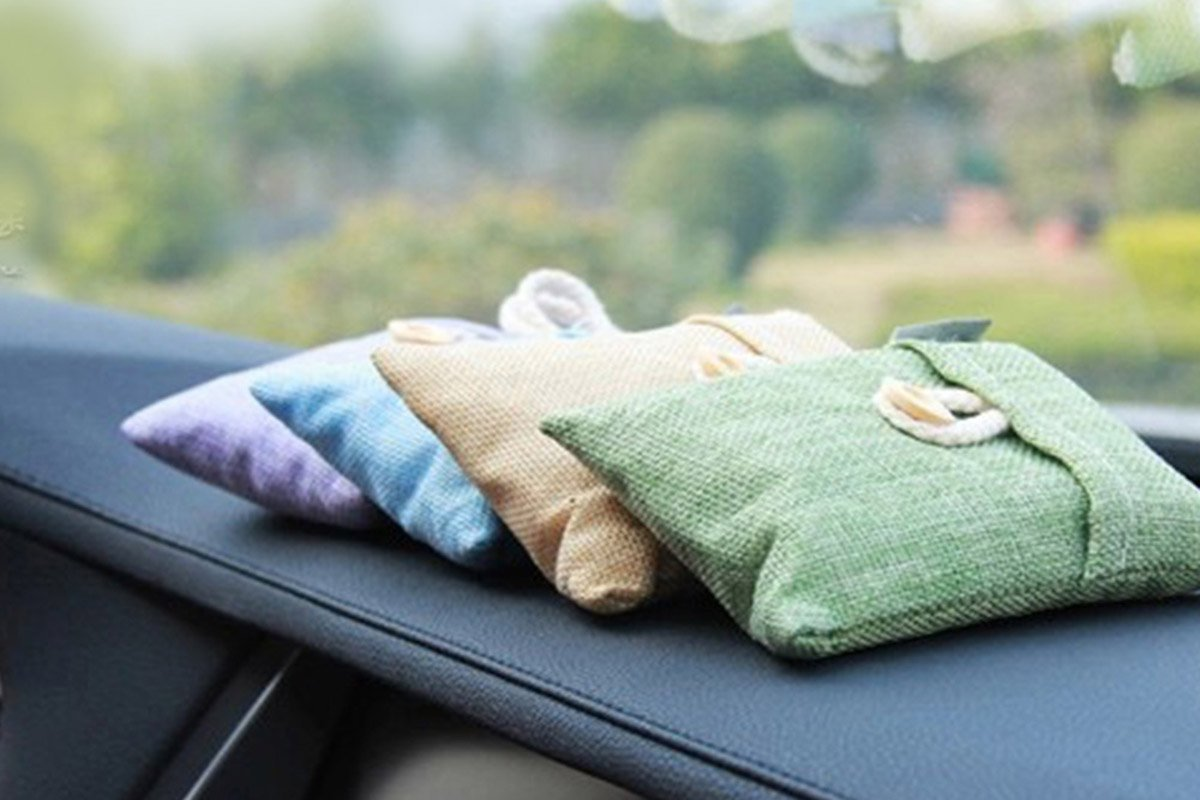 Four colorful bamboo charcoal bags on a car console