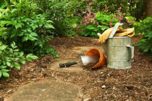 Bamboo mulch in a garden with gardening tools