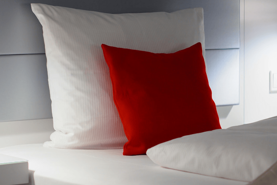Red and white bed pillow