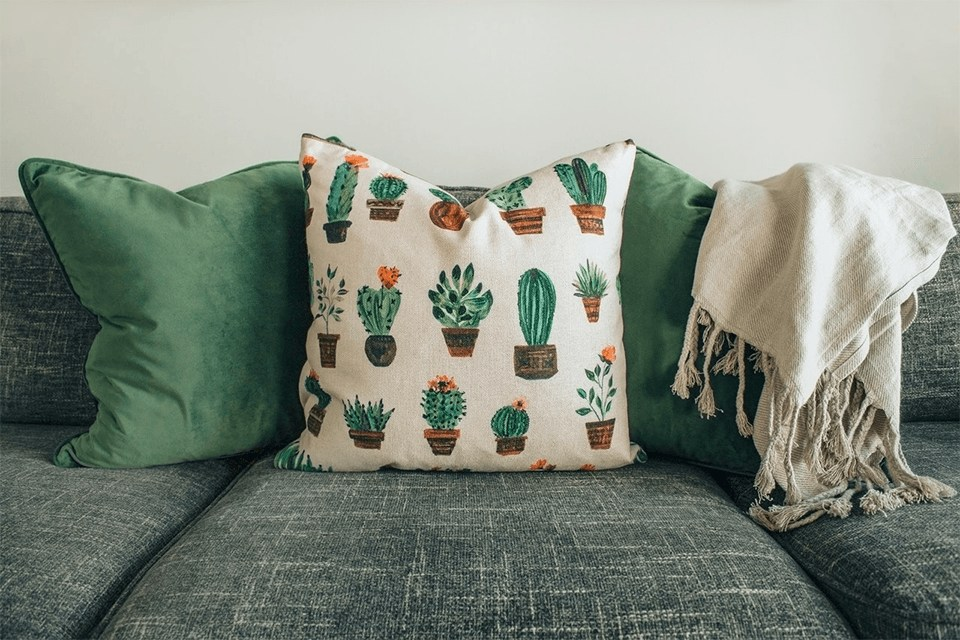 White and green throw pillow